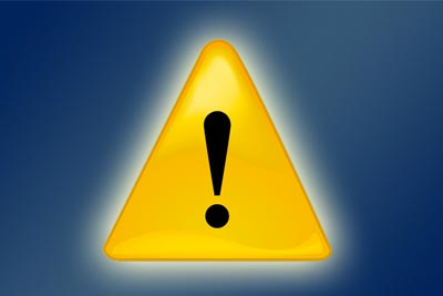 yellow alert symbol on blue background