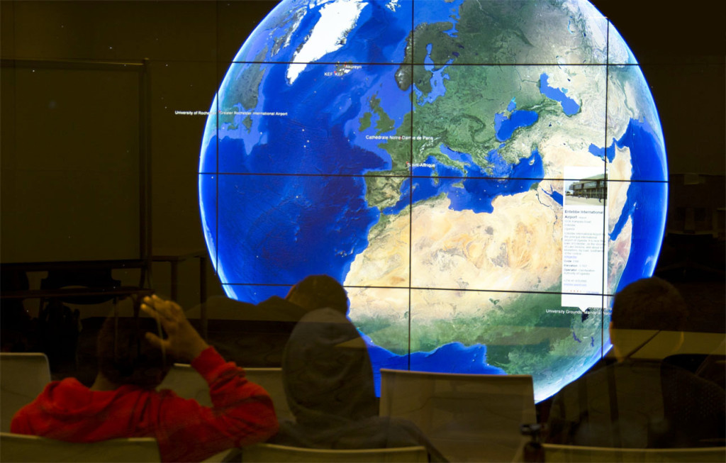 students viewing globe